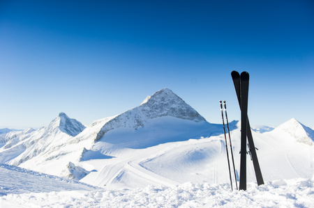ski slopes: Skis in high mountains at sunny day Stock Photo