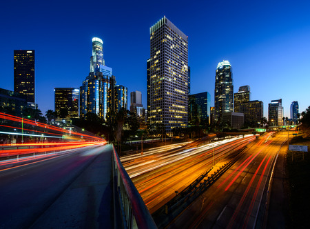 City of Los Angeles California at sunset with light trails photo