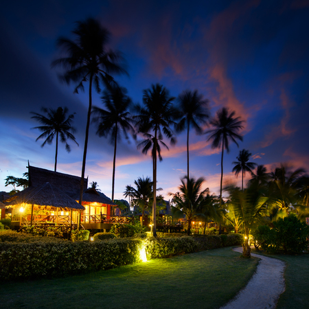 polynesia: Bungalows at sunset in thailand paradise Stock Photo