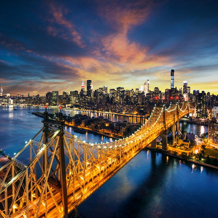 aerial view city: New York City - amazing sunset over manhattan with Queensboro bridge