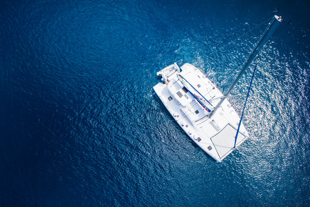 amazing view to catamaran, swimming woman and clear water caribbean paradise