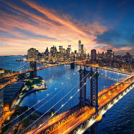 manhattan: New York City - beautiful sunset over manhattan with manhattan and brooklyn bridge Stock Photo