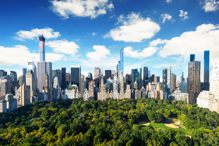 city park skyline: New York City - central park view to manhattan with park at sunny day - amazing birds view