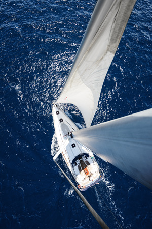 yacht race: Sailing Yacht from mast at sunny day with deep blue ocean