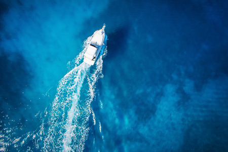 speed boat: amazing view to yacht, swimming woman and clear water caribbean paradise Stock Photo