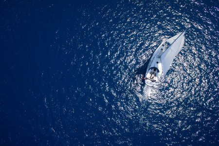 birds eye view: Amazing view to Yacht sailing in open sea at windy day. Drone view - birds eye angle