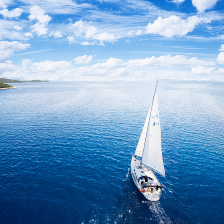 Yacht sailing on open sea at windy day Stock Photo