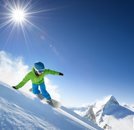 snowboard: Snowboarder skiing in high mountains. Stock Photo