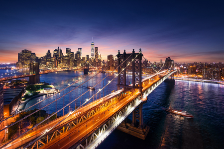 New York City - beautiful sunset over manhattan with manhattan and brooklyn bridge Imagens