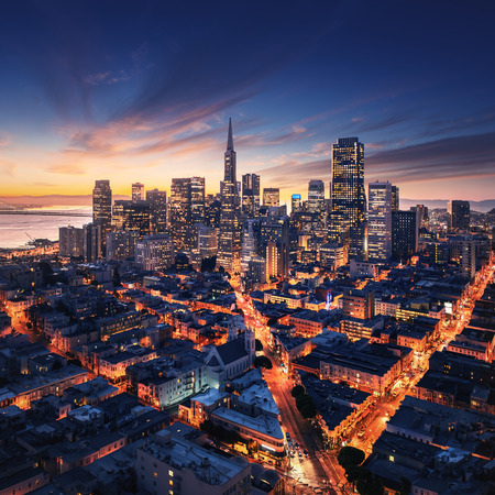 San Francisco aerial view from sea side. Port of San Francisco in the front. City downtown and skyscrapers at sunrise.