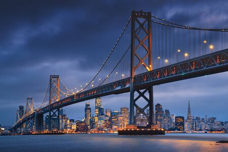 San Francisco downtown with Oakland Bridge in foreground. California famous city SF. Travel destination USA