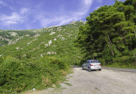 Kotor Serpentine, Mountains of Montenegro - 08.11.2014: Tourist travels by car along dangerous mountain roads of Montenegro