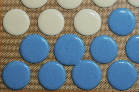 Blue and white Raw macarons before oven