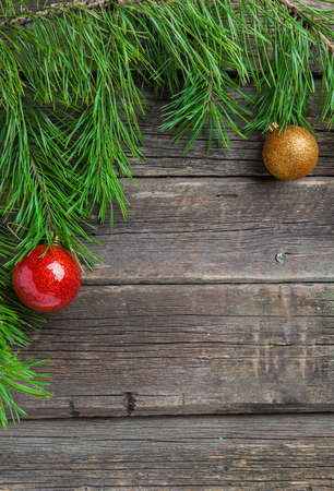 Vintage Cristmas decoration with fir branch over old wooden background. Flat lay, text space