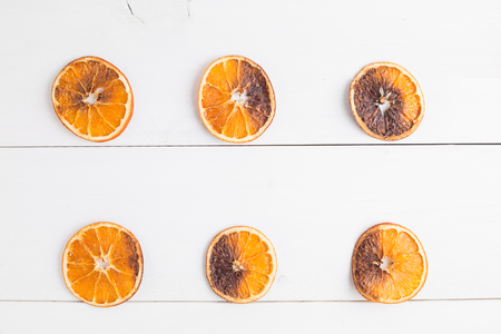 Dried oranges on a wooden background