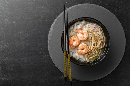 Vietnamese Pho tom noodle broth asian soup prawn. Top view with copy space Stock Photo