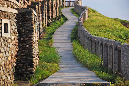 An upslope path to a sea shore hill at Hoping island, Keelung, Taiwan  photo