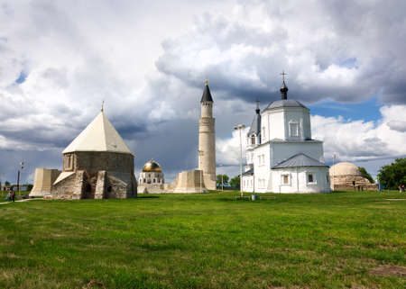 The unity of religions, the Christian Church and the minaret of the mosque of Bolgar city, Russia. Reklamní fotografie