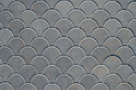 Gray paving slabs of original shape, texture, background