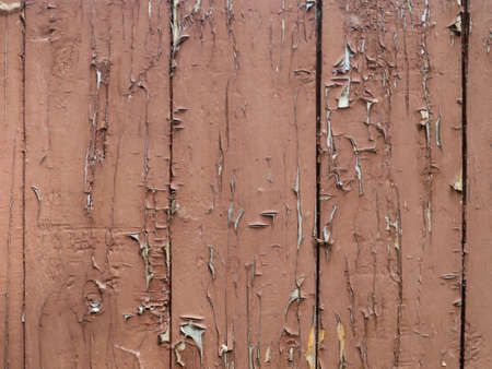 Peeled brown paint on old wooden wall. Banque d'images