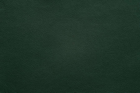 Dark green faux leather with large texture, background.