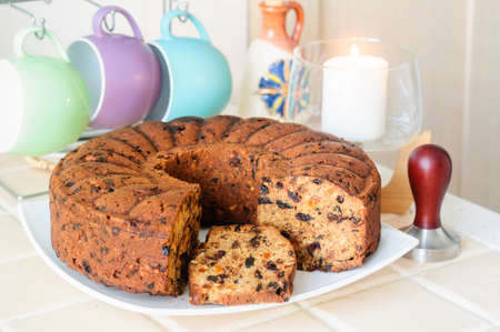 Cake with dried fruits and nuts, cups for tea, temper, selective focus.