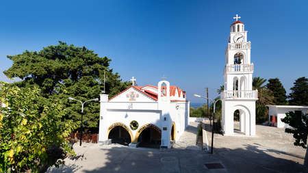 The Church and the bell tower of the monastery Tsambika, Greece.