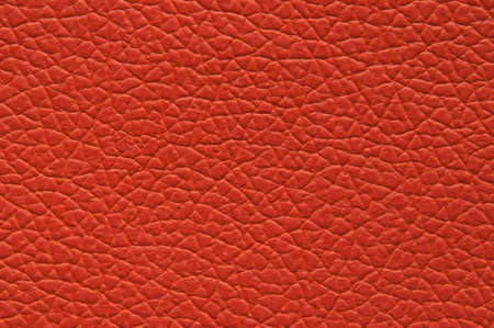 Highly saturated orange orange artificial leather with large texture, macro.