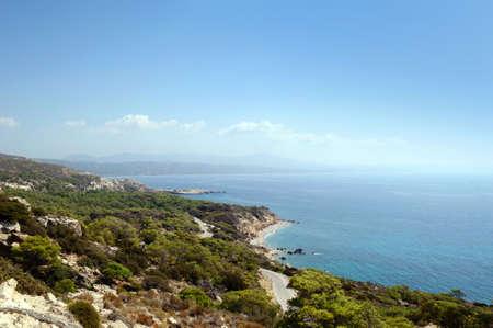 Rocky coastline of the Aegean coast, Rhodes, Greece.