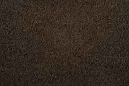 Chocolate brown artificial leather with large texture, background.