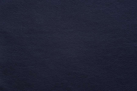 Dark blue faux leather with fine texture, background.