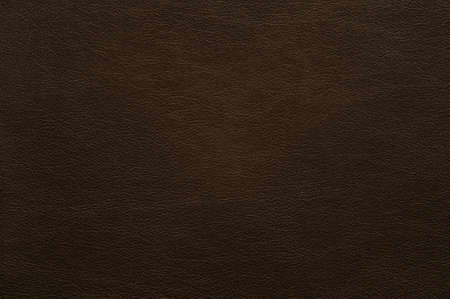 Dark brown faux leather with fine texture, background.
