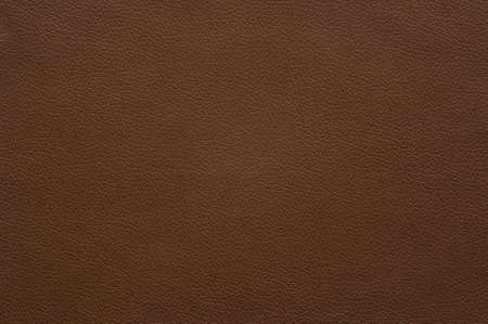 The texture of the surface of artificial leather brown, background.
