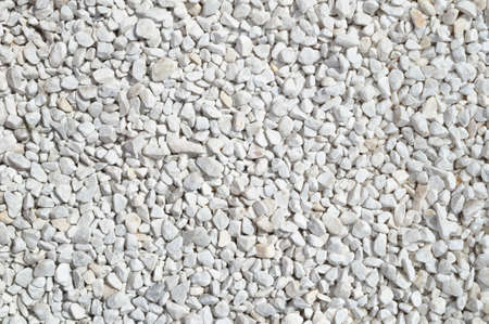 Light gray gravel on the path, light crushed stone texture, background.