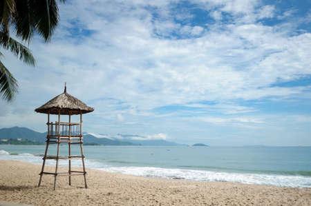 Old wooden lifeguard tower on the seashore, Vietnam.