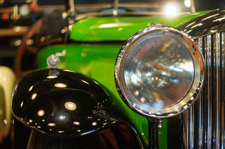 Close up of headlight of classic cars, shallow depth of field.