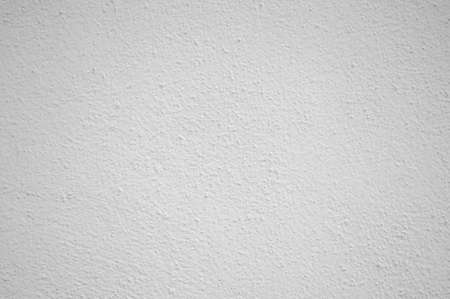 White painted rough wall surface, background.
