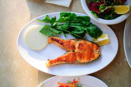 Grilled salmon steak in Istanbul street cafe. Banco de Imagens