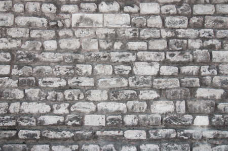 An old wall of white uneven brick. Banco de Imagens