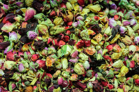 Colorful dry rose buds in the street market.
