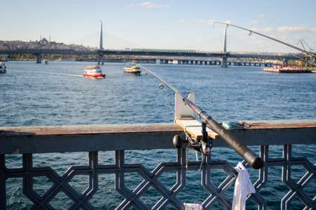 Rod fishing from the Galata bridge in the Strait of the Golden horn, Istanbul.