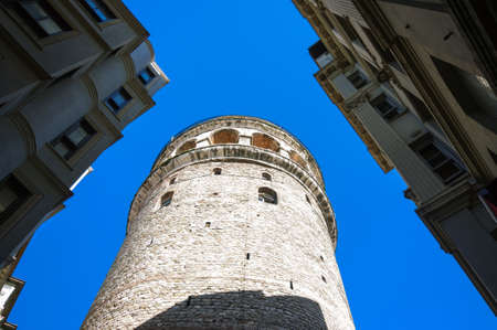 Bottom view of Galata tower against blue sky, Istanbul.