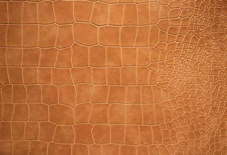 Texture brown faux leather with a variable cell, background.
