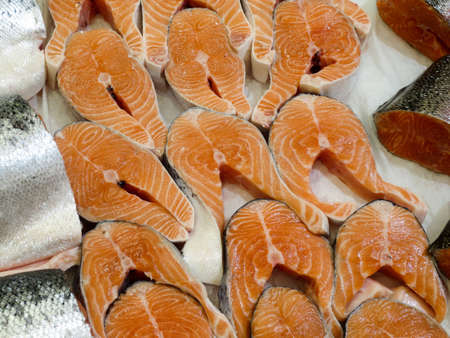 Fresh red fish steaks on the counter, background. Banco de Imagens