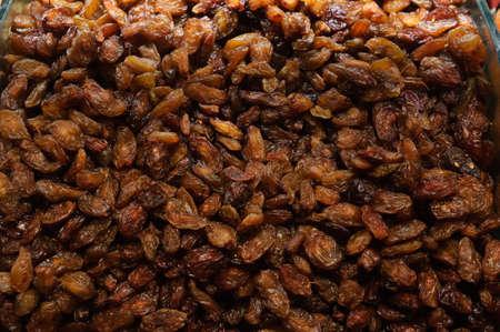 Large brown raisins top view.