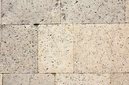 Texture of stone slabs of the old wall, background.
