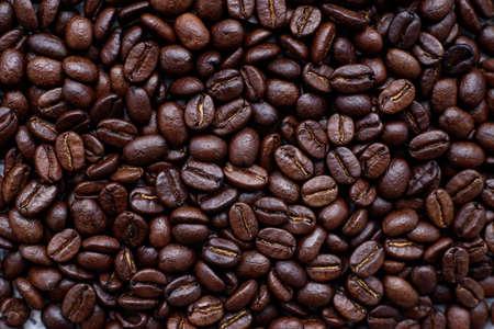 Top view dark roasted arabica coffee beans, background. Stock fotó