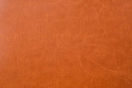 Texture of natural bright brown leather.