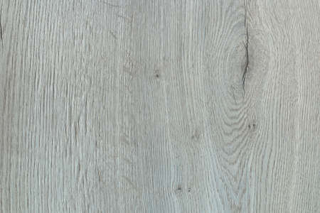 Laminated panel with grey wood texture