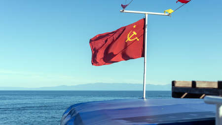 Red flag of the Soviet Union on the ship.